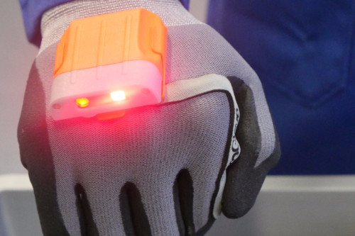 BMW is also testing 'ProGloves' in production. Portable scanners can be fixed directly to workers' gloves (with a thumb-activated switch aligned with the index finger) to save people unnecessary hand and finger movement