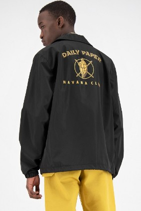 The collaboration includes a clothing line featuring the Havana Club logo