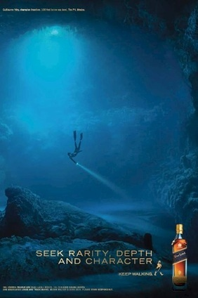 The Johnnie Walker Blue Label ad features a world-champion free diver